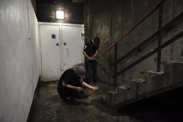 James Muir and his friend Tony Nugent inject drugs in a safe place which is known to many users in the centre of Glasgow. Tony (back) tries to inject into a femoral vein and James prefers his arms, bu...
