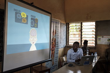 A slide is displayed on a screen during a drug education session presented by local NGO Alliance Nationale des Consommateurs et de l'Environnement (ANCE) at the Blaise Pascal school complex. Amongst t...