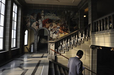A wall mural 'The Irish Industrial Revolution', in a stairwell at the WTO headquarters. The wall mural, was a gift to the ILO which previously occupied the building.   The World Trade Organisation h...