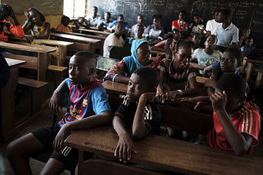 Young people listen during a drug education session presented by local NGO Alliance Nationale des Consommateurs et de l'Environnement (ANCE) at the Blaise Pascal school complex. Amongst the topics cov...