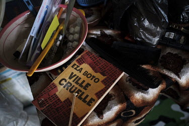 An old school book belonging to Ayao (not his real name) in his bedroom. The 15 year-old is addicted to tramadol, a prescription-only opioid analgesic intended for the treatment of moderate to moderat...