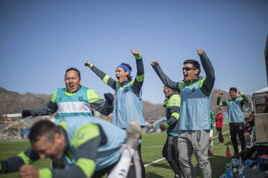 Nukannguaq Petersen (with headband) and his teammates from Greenland football league side N48 celebrate the goal that will put them into the final of the tournament that they would go on to win.~~The...