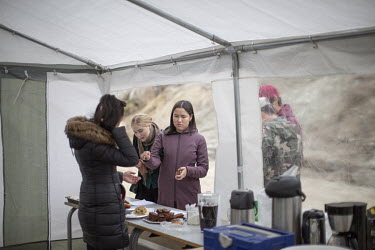 The official catering stand in the form of a drink and snack tent below the spectator's area.~~The Greenland soccer league's season lasts less than a week, with its six teams playing five games in as...