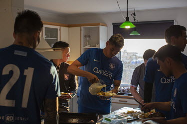 Reindeer and fries is consumed by players from Greenland football league side G-44 during their after-game dinner.~~The Greenland soccer league's season lasts less than a week, with its six teams play...
