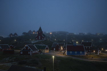 Sea fog envelopes the town of Sisimiut, the second largest in the country with a population of around 5,500 people.