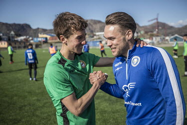 Hans Brummerstedt (L) of Greenland soccer league side GSS embraces a rival from B-67. Hans used to play for B-67 but was unable to make all the training sessions while studying for his university degr...