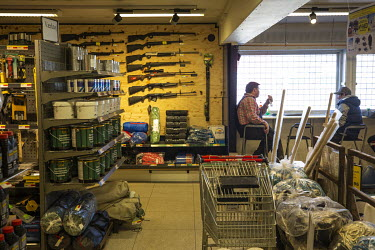 Guns sold alongside paint and tools in the local hardware store.