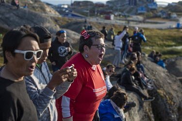 Helga Zeeb, a superfan of Greenland football league side G-44, leads the chanting but often sings alone from the cliffs surrounding the Sisimiut stadium.~~The Greenland soccer league's season lasts le...