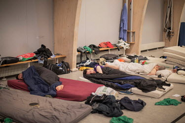 Members of GSS team sleeping on the floor of a school gym hall shared with team E-54. The two teams played the night before with GSS losing to E-54 and a player from each team taken to hospital for in...