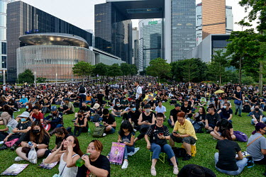 People gather in front of government buildings in the Admiralty District to commemorate the 5th Anniversary of the start of the 2014 'Umbrella Revolution'.