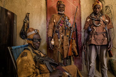 A group of Dozo hunters from the Bambara ethnic group armed with various weapons and wearing protective amulets. A pan-ethnic society that have long existed across several West African countries, grou...