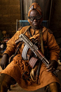 A Dozo hunter from the Bambara ethnic group armed with various weapons and wearing protective amulets. A pan-ethnic society that have long existed across several West African countries, groups of Dozo...