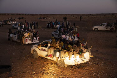 Vehicles packed with migrants from all across West Africa set off to cross the Tenere, a region of the Sahara Desert, in order to reach Libya and beyond.