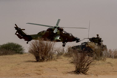 A Tiger helicopter and an armoured vehicle belonging to French forces taking part in Operation Koufra which is part of Operation Barkhane. The soldiers were searching for Islamist terrorists from EIGS...