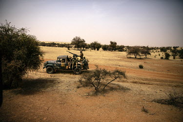 Members of FAMA (Malian Armed Forces) armed with a heavy machine gun mounted in the rear of a pick up truck participates with the French army in Operation Koufra which was part of the larger Operation...