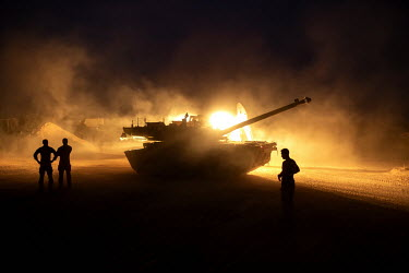 A French tank is illuminated by lights at a military base during Operation Koufra which was part of the larger Operation Barkhane. The soldiers were searching for Islamist terrorists from EIGS (Islami...