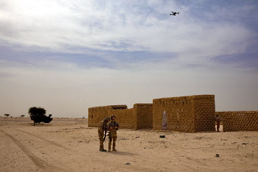Two French soldiers operate a drone while taking part in Operation Koufra, part of Operation Barkhane. The soldiers were searching for Islamist terrorists from EIGS (Islamic State in the Great Sahara)...