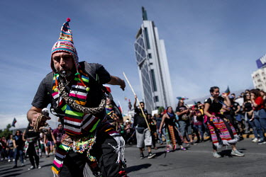 Protesters wearing indigenous regalia march through Santiago. Demonstrations against the government started on 18 October, initially to protest rises in metro fares in Santiago. They quickly spread to...