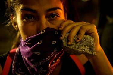 Natalie, a 24 year old protester, shows the signs of tear gas as she holds a rock in her hand during anti-government protests. Demonstrations against the government started on 18 October, initially to...
