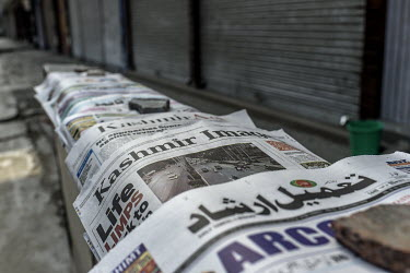 Newspapers displayed on a vendors stall soon after the Indian government's scrapping of article 370.