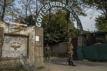 Security personal stand guard outside the government S P Model higher secondary institute which remains closed leading to uncertainty about exams which are due to take place at the end of October. The...