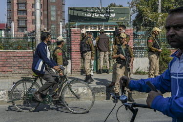 Security personal stand guard outside a park closed due to a curfew put in place following the Indian government's decision to revoke article 370 which gave Kashmir a degree of autonomy.