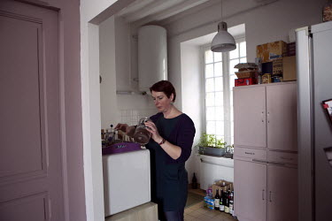 The Mont Saint Michel administrator's assistant, Anne-Flore Marziou, making coffee in her apartment on the first floor of the Fanils fortified enclosure, a former barracks that became the prison guard...
