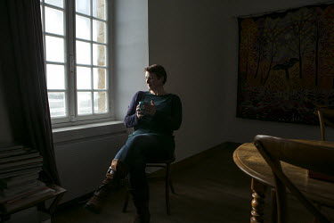 The Mont Saint Michel administrator's assistant, Anne-Flore Marziou, drinking coffee in her apartment on the first floor of the Fanils fortified enclosure, a former barracks that became the prison gua...