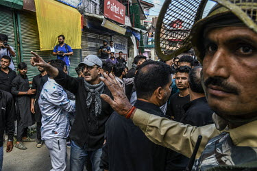 Men taking part in a Muharram procession clash with security forces during a clamp down following the Indian government's decision to revoke article 370 which gave Kashmir a degree of autonomy.