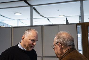 Jaroslaw Kurski (left) vice editor-in-chief of Gazeta Wyborcza, the largest opposition newspaper in Poland, talking with editor-in-chief, Adam Michnik, at the newspaper's headquarters.