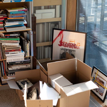 Books and papers piled up in a corner in Adam Michnik's office. Michnik is the editor-in-chief and founder of Gazeta Wyborcza, the largest opposition newspaper in Poland.