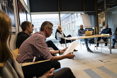 Jaroslaw Kurski (centre left), vice editor-in-chief of Gazeta Wyborcza, the largest opposition newspaper in Poland, during the daily meeting at the newspaper's headquarters.