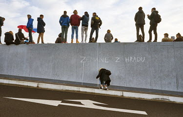 A young woman writes 'Zemane Z Hradu', a protest aimed at Czech president Zemane during a demonstration that saw around 250,000 people gather in Letna Park on the eve of the 30th anniversary of the Ve...