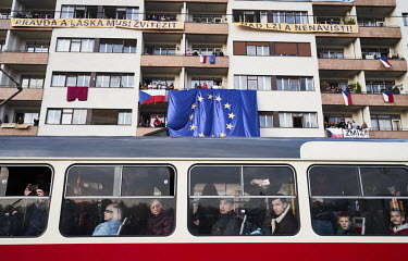 A tram passes a demonstration that saw around 250,000 people gather in Letna Park on the eve of the 30th anniversary of the Velvet revolution to demand the resignation of Prime Minister Andrej Babis....
