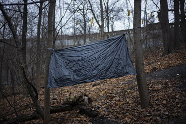 A privacy blind set up at an encampment of homeless people in Rosedale Valley.