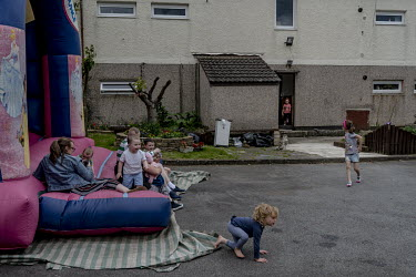 A children's birthday party at An Cro Mor, a squatted community centre in the Creggan area of Derry. During the Troubles, this area was a car park where two IRA men died as they were making bombs. Ano...