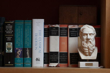 A bust of Herodotus and books in the home of author and historian, Tom Holland, in south London. Tom has a new book out, Dominion, about how Christianity has shaped the Western world.