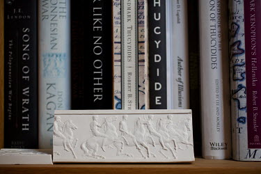 A replica frieze and books in the home of author and historian, Tom Holland, in south London. Tom has a new book out, Dominion, about how Christianity has shaped the Western world.