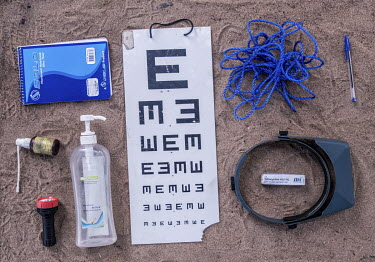 Equipment, including a 'tumbling E' chart, used by a mobile team for conducting eye tests and examinations.