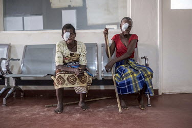 Sahura Mussa and Aziza Daudo wait to have their bandages removed the day after undergoing an operation to remove their cataracts at the Nampula hospital.
