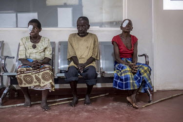 Sahura Mussa and Aziza Daudo wait to have their bandages removed the day after undergoing an operation to remove their cataracts at the Nampula hospital. Sahura's husband, Gordane (70), sits between t...