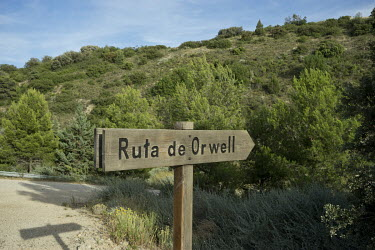 A sign indicates the 'Ruta de Orwell', an area of trenches and air raid shelters where George Orwell fought for the Republican side against Franco's falangists during the Spanish Civil War.