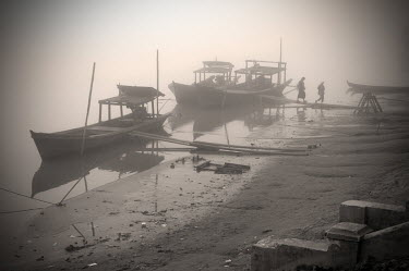 Passenger boats moored on the banks of the Irrawady River in Kathar, which George Orwell placed in the fictional district of Kyauktada for his novel Burmese Days.