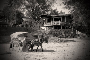 A horse and cart pass the police station in Kathar, which George Orwell placed in the fictional district of Kyauktada for his novel Burmese Days.