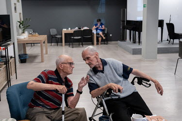 Two elderly men talking together at a centre built for surviving veterans of the Warsaw Uprising.