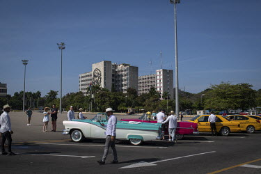 Vintage American cars parked in Plaza de la Revolucion (Revolution Square).