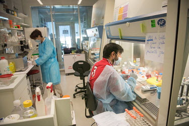 HIV/AIDS researchers in a laboratory at the Institut Pasteur.