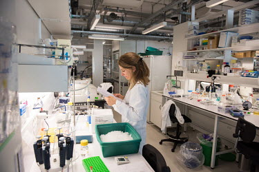 An HIV/AIDS researcher in a laboratory at the Institut Pasteur.