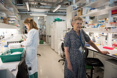 Francoise Barre-Sinoussi and an HIV/AIDS researcher in a laboratory at the Institut Pasteur.