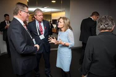 Sharon Lewin (right) speaking with Denis Napthine (left), Premier of Victoria, and Victoria Health Minister David Davis (centre) during the 20th International AIDS Conference held at the Melbourne Exh...